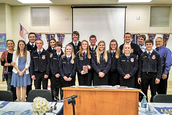 Colmesneil FFA student officers hosted a parent-member banquet for the incoming officers, parents, teachers and administration Tuesday evening May 19 to a full room. In the photo are the year's outgoing and incoming officers (L-R), Ag. Teacher Katie Martin, Superintendent Angela Matterson, Blaine Turner, Morganne Ross, Diana Montgomery, Mallory Monk, Jake Pattillo, Shelby Tally, Andrew Harmon, Sarah Davis, MvKenzie Rogers, Hunter Rawls (top), Alicyn Mitcham (bottom), Ag. Teacher Matt Swinney, Kameron Lindsey and HS Principal Walter McAlpin.
