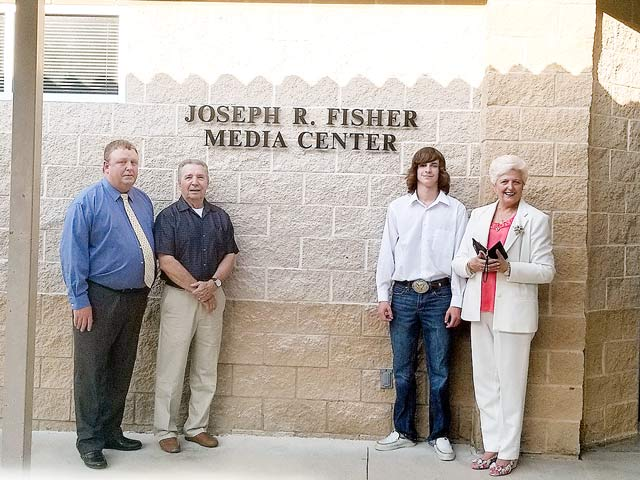 Superintendent Kendall Smith Carl Fisher, Zack Fisher, & Glenda Fisher attended the opening of the Joseph R. Fisher Media Center honoring former superintendent.