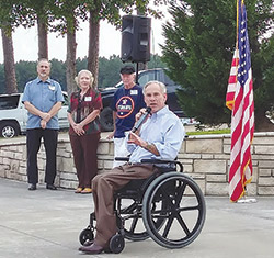 Gov. Greg Abbott addressed the crowd of supporters who attended a dinner in his honor Sept. 27 at Grissom's Golden Pine. (Valerie Reddell photo)