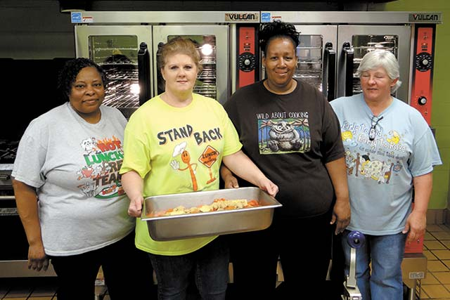 Colmesneil ISD gets new ovens—New ovens at Colmesneil ISD will improve service for decades to come: (l-r) Bernice Gilder, Sylvia Flores, Food Service Director Janey Butler and Tessey Ross.