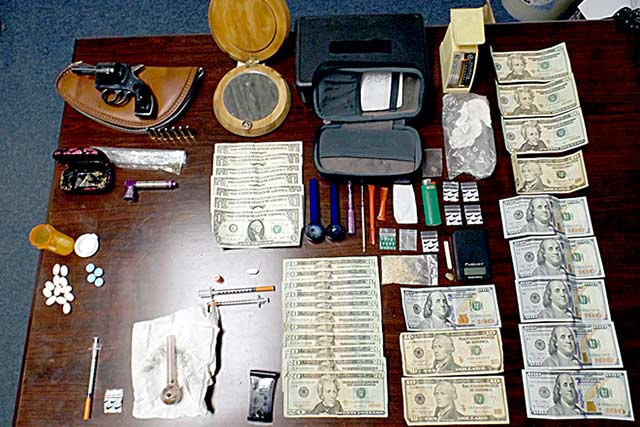 Drugs, money and drug paraphernalia confiscated from Ivanhoe home during a drug raid May 4.