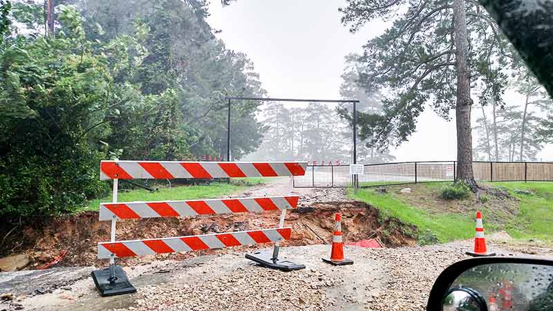 Lake Tejas in Colmesneil incurred severe damage from the flooding and will be closed to June 18, per CISD Superintendent Matterson.  As seen in the photo, the entrance culvert was washed completely away. (Michael Maness Photo)