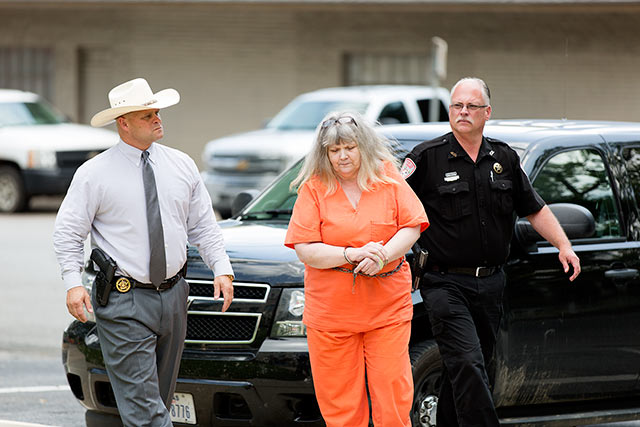 Letha Wesfall is escorted into court in Woodville Tuesday where she pled guilty to Engaging Organized Criminal Activity. She was sentenced to life in prison. (Emily Waldrep Photo)