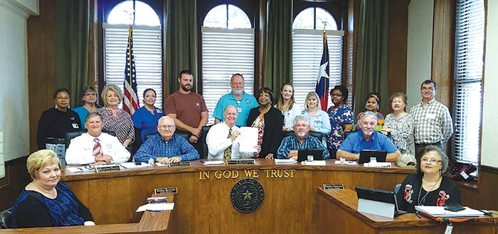 Tyler County Hospital department heads joined county officials Tuesday for the signing of a proclamation that designates Nov. 16 as National Rural Health Day in Tyler County. (Photo by Valerie Reddell)