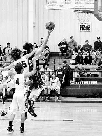 Junior, Cord Neal draws a foul against Spurger. Neal put 16 points on the board, had nine rebounds and one block.