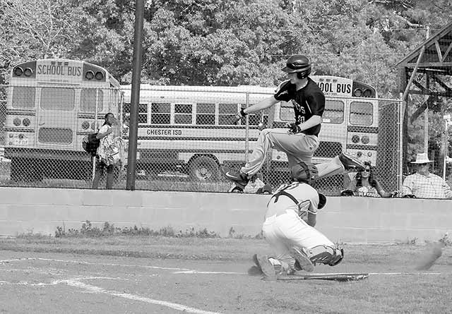 Billy Thompson uses his athletic ability to jump the catcher and score for the Jackets. (Wendy Whitworth photo)