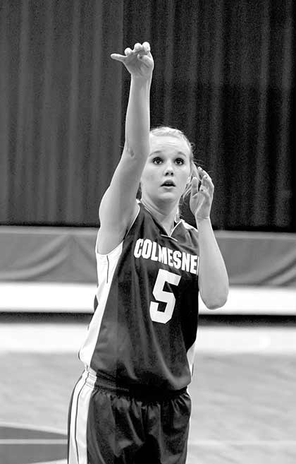 Haleigh Belt shoots a free throw after driving baseline and drawing a blocking foul against Hull-Daisetta defender.  (Colmesneil Yearbook Staff Photo)