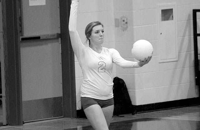 Kara Standley serving the volleyball during a match her senior year. Standley was named TGCA Academic All-State in both volleyball and track and field. (Photo Colmesneil Yearbook Staff)