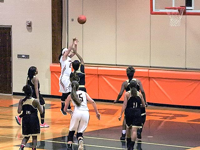 Warren's Erin Foster (12) attempts jump shot against Anahuac. (Doug Glosson Photo)