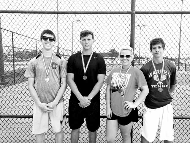Warren Varsity Tennis—Shown, from left, are John Applewhite, Cameron Kojak, Jami Miller, and Seth Brown at district tennis tournament. (Coach Ronate Sloan Photo)