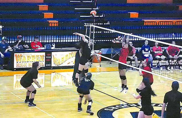 Senior Laikyn Bell with the kill against Groveton. (Doug Glosson photo)