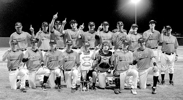 The varsity Warrior baseball team with their championship trophy. (Liz Fry Photo)