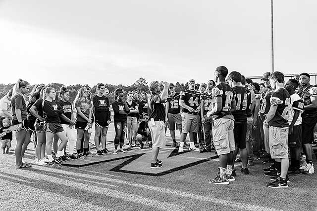 Coach Troy Carrell directs the Eagles just prior to athlete introductions during Meet The Eagles. (Hale Hughes Photo)