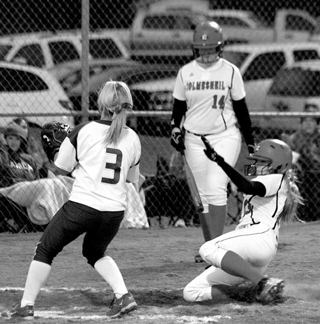 Kara Standley sliding into home plate for what would end up being the winning run in the Lady Dogs 4-3 victory over the Lady Eagles of Zavalla. (Colmesneil Yearbook Staff photo)