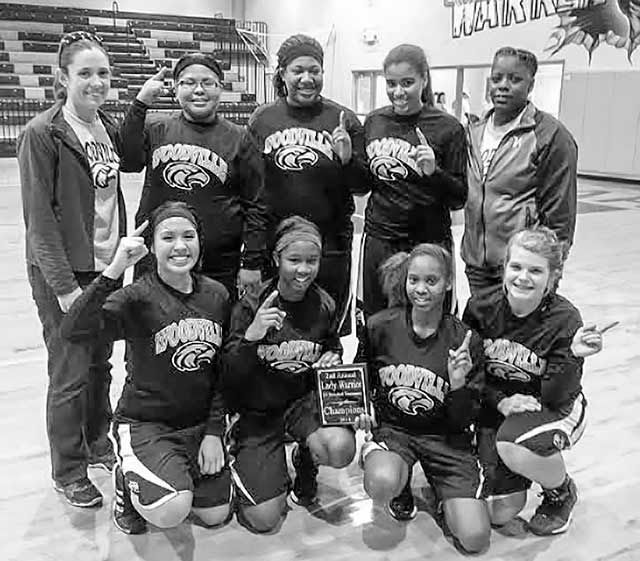 JV Lady Eagles—Top Row: Coach Sarah Blair, Crailee Battise, Jailynne Menefee, Chelsie Sargent and Coach Michelle Merchant.  Bottom Row: Karrigan Young Eveona Williams, Crystal Martin and Savanah Jordan.