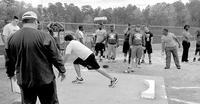 Miguel Falcon throwing the shot put at the district meet Monday. (Jason Drake photo)