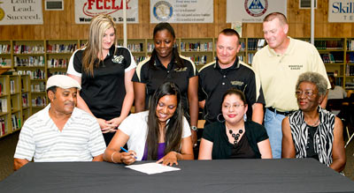 Destiny Gill signing with Wiley College.
