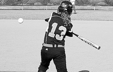 Senior Meagan McCluskey swings at a fast pitch. (Mitchell McCluskey Photo)