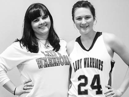 Senior Lauren Foster and senior manager Lindsey Seago enjoy their senior night. (Katie McCluskey photo)