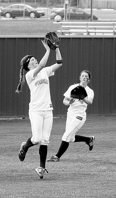Ashton Weatherford catches a pop fly in the outfield while Katie Watts backs her up. (Lori Bronstad Photo)