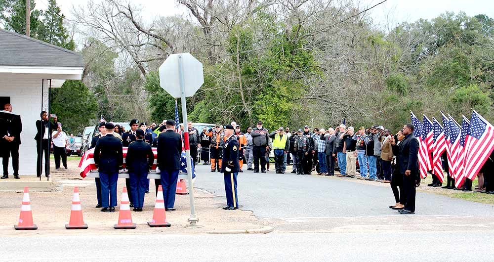Crowds come out to pay respects to fallen hero