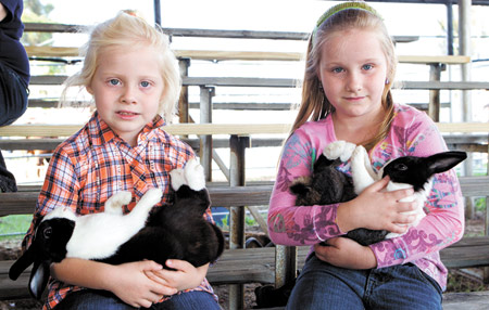 Don't Miss This Year's Tyler County Fair—These young girls showed the fine rabbits in last year's fair. (Jim Powers Photo)