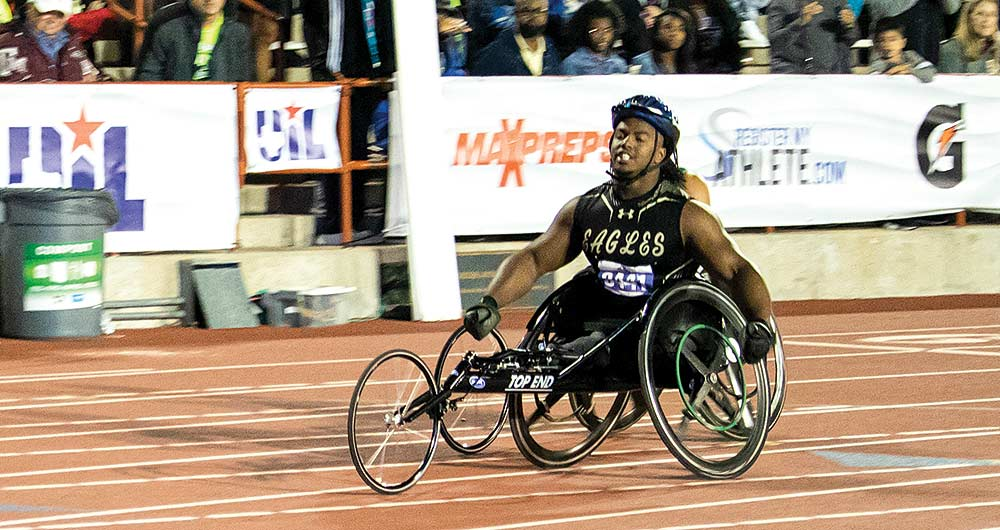 Woodville senior Carrington Marendes rolls into a victorious finish in the 400-meter wheelchair dash event at the UIL State Track Meet, held in Austin last weekend. Marendes, a standout athlete at WHS, medaled in all three events he competed in at the meet. (CHRIS EDWARDS | TCB Photo)