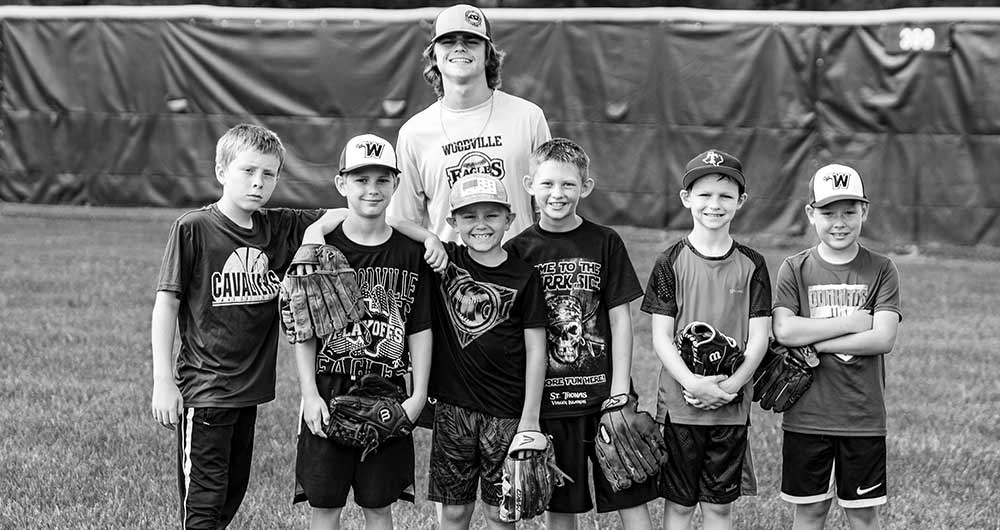 "Eagle Eggs – Woodville Junior Kyler Coleman stands behind a handful of players during last week's camp held at Hennigan Park.""he makes a catch while in a full sprint.""(HALE HUGHES 