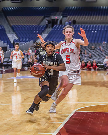 Tenacious Telia – Woodville's Telia Jackson (3) races past a Chapel Hill defender for a score in the state championship game in the Alamodome. (HALE HUGHES | TCB PHOTO)